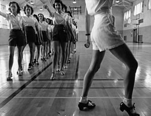 English: Tap dancing class in the gymnasium at...