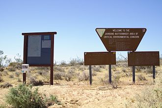 Area of Critical Environmental Concern - Faded signage for the Jawbone-Butterbredt ACEC in the Mojave desert