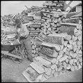 Jerome Relocation Center, Dermott, Arkansas. Evacuees at the Jerome Relocation Center chop their ow . . . - NARA - 538198.tif