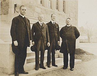 Lyons (right) and his brother, Frederick, (second from right) in 1916 Jessup, Mooney, Lyons, and Lyons at Boston College.jpg