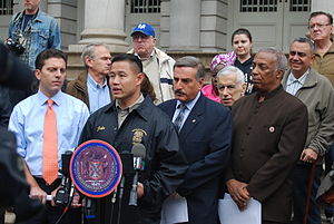 New York City Councilman John Liu (at the podi...