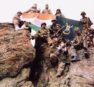 Indo-Pakistani wars and conflicts - Indian soldiers after winning a battle during the Kargil War.