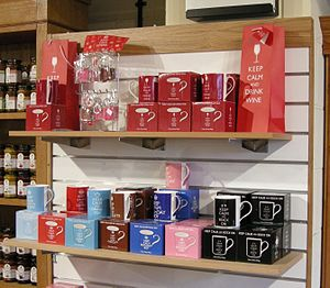 """Keep Calm and Carry On - Shop display of """"Keep Calm"""" merchandise, including the original slogan and variants such as """"Keep Calm and Drink Tea""""."""