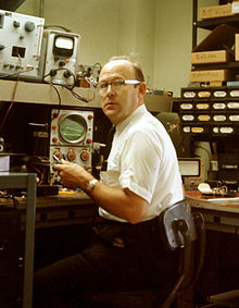 Keneth Alden Simons at his Jerrold Electronics workbench in the 1960s