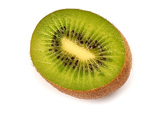This image shows a cut kiwifruit.