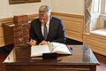 Kosovo President Thaci Signs the Guest Book (49589029387).jpg