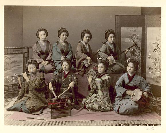 Kusakabe Kimbei - 11. Playing samisen, tsudzumi, fuye, and taiko.jpg