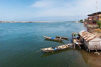 Cotonou - The Oueme River as it flows into the Atlantic Ocean at Cotonou