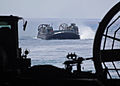 Landing Craft, Air Cushion 84 approaches the well deck of amphibious transport dock ship USS New York (LPD 21) after pre-staging 24th Marine Expeditionary Unit assets in Cap Draa, Morocco, April 9, 2012, before 120409-N-NN926-074.jpg