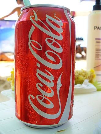 Acid - Carbonated water (H2CO3 aqueous solution) is one of the  main ingredients listed the ingredient sheet of a can of Coca-Cola.