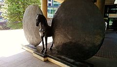 Union (Horse with Two Discs): a public sculpture by Christopher Le Brun outside the Museum