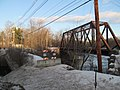 Lewiston & Auburn Railroad and Portland-Lewiston Interurban bridges in Auburn, Maine, January 2017.JPG