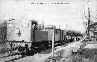 Île-de-France tramway Line 4 - A train arriving at l'Abbaye during the Compagnie du Bondy-Aulnay era.