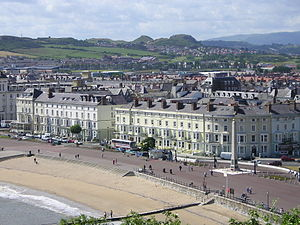 Llandudno - Llandudno South Parade (on the north shore) viewed from the Great Orme, with the twin mounds of Deganwy Castle in the distance
