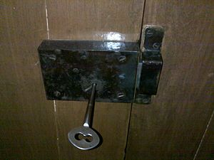 Warded lock - An old-style warded lock which is rim mounted to a door