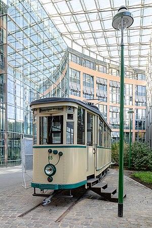 Tram (railcar 65) in the Stadthaus 3, Muenster, North Rhine-Westphalia, Germany
