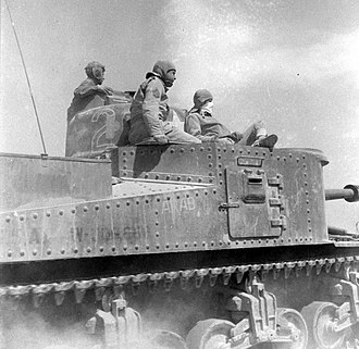 "13th Cavalry Regiment - The crew of ""ARAB."" An M3 Lee tank of the 13th Armored Regiment, El Guettar, Tunisia, 1943."