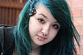 Maddy from Manchester with her blue-green hair and her facial piercings.jpg