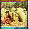 Man with camel loaded with packs LOC 9631427594.jpg
