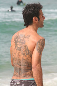 Man with tattoo on his back - at the beach.JPG