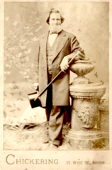 Man with tophat by Chickering of 21 West Street in Boston.png