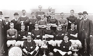 1908–09 Manchester United F.C. season - The Manchester United FC team of 1909 posing with their trophies won, they are: FA Charity Shield, the Football League (First Division, won in 1907-08) and the FA Cup.