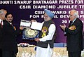 Manmohan Singh giving away the Shanti Swarup Bhatnagar Prize for Science and Technology 2007 to Dr. Anil Bhardwaj of Thiruvananthapuram for his outstanding contribution in Earth, Atmosphere. Ocean and Planetary Sciences.jpg