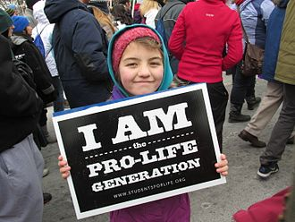 March for Life (Washington, D.C.) - A young girl holds up a pro-life sign.