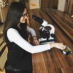 Me with microscope.jpg