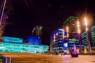MediaCityUK - The MediaCityUK Piazza seen at night during the MediaCityUK Lightwaves Festival 2018 looking towards dock10, the BBC and Salford University.