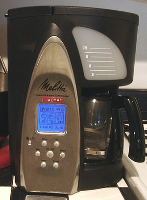 Smart Personal Objects Technology - A Melitta drip coffeemaker displaying a weather forecast on an electronic visual display powered by SPOT