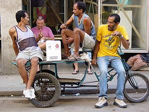 Men on street with bicycle cart, Centro Habana...