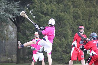 Field lacrosse - A lacrosse player shooting during a game.