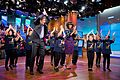 "Michelle Obama and Dr. Mehmet Oz learn a dance routine during a taping of the ""Dr. Oz Show"", 2013.jpg"