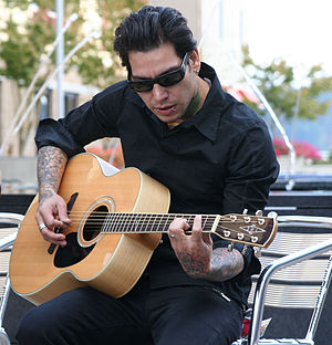 "MxPx - Band bassist Mike Herrera performing ""Move to Bremerton"" in 2006."