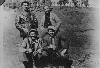 Miladin Popović - Miladin Popović, standing to the left, and Dušan Mugoša, sitting to the left, with Enver Hoxha sitting to the right, in Albania in 1942–43.