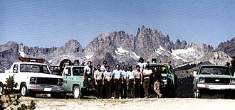 Minaret Summit - The Minarets behind the Mammoth Ranger District Fire Crew (Inyo National Forest) at Minaret Summit Vista Point circa August 1984. Steve Fossett's remains were found approximately at the spot in the distance behind the leftmost fireman.