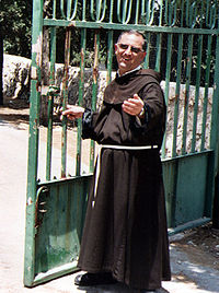 Franciscan friar wearing traditional habit at monastery of the Church of the Transfiguration on Mount Tabor, Israel.