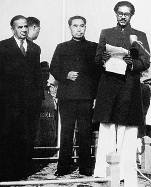 Bangladesh–China relations - Zhou Enlai (centre) with H. S. Suhrawardy (left) and Sheikh Mujibur Rahman (right) in Dhaka Stadium, 1957