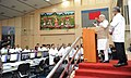 Narendra Modi addressing at the Mission Control Centre after the successful launch of PSLV - C 23, at Sriharikota, in Andhra Pradesh on June 30, 2014. The ISRO Chairman, Dr. K Radhakrishnan is also seen (1).jpg
