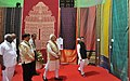 Narendra Modi visiting the Handloom exhibition, in Chennai, Tamil Nadu. The Minister of State for Textiles (Independent Charge), Shri Santosh Kumar Gangwar, the Minister of State for Road Transport & Highways and Shipping.jpg
