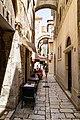 Narrow street in Split, Croatia (48693915982).jpg