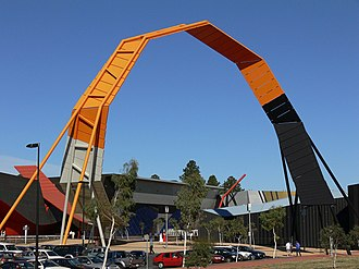 The National Museum of Australia established in 2001 records Australia's social history and is one of Canberra's more architecturally daring buildings. NatMusAus Main Entrance Strip.jpg