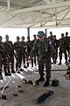Nepalese soldiers with the Birendra Peace Operation Training Center receive a brief from Republic of Korea Army Capt. Jin Hak Jung, center, with the 11th Special Forces Brigade, at the vehicle checkpoint 130807-M-DR618-015.jpg