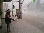 Newspaper seller Kelud eruption 2014.jpg