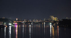 View of Sylhet's skyline and the Keane Bridge from the Surma River at night