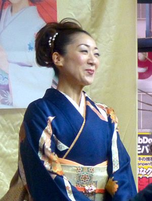 Enka - Enka singer Yuki Nishio performing in front of a music shop in Chiba, Japan.