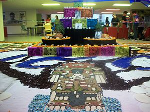 Sawdust carpet - Day of the Dead altar with sawdust carpet depicting the god Tlaloc at ITESM Campus Ciudad de México.