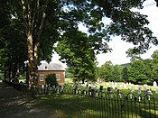 The small church and cemetery, behind the iron fence