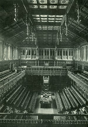 House of Commons of the United Kingdom - Another picture of the old House of Commons chamber. Note the dark veneer on the wood, which was purposely made much brighter in the new chamber.